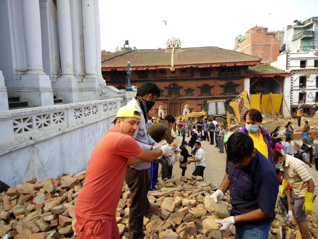 150530 KATHMANDU May 30 2015 Volunteers clear the debris of damaged temples at the Basanta